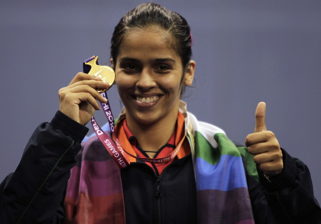 India's Nehwal poses with her gold medal after winning the women's singles badminton finals at the Commonwealth Games in New Delhi