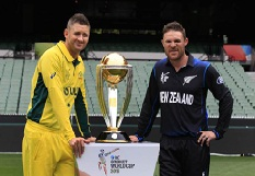 Melbourne: New Zealand ODI team captain Brendon McCullum and Australian ODI team captain Michael Clarke during a photo shoot with the Cricket World Cup trophy at the Melbourne Cricket Ground in Melbourne, Australia, on March 28, 2015.  (Photo: IANS)